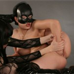 Two nude contortionists in masks playing wild lesbian games