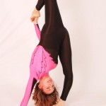 Sexy female contortionist in spandex suit